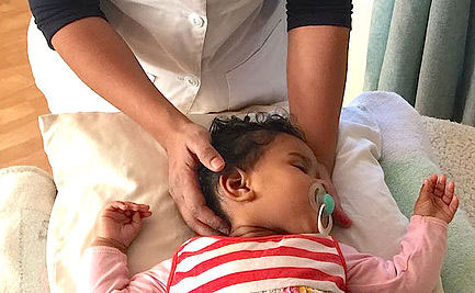 baby being treated with cranial osteopathy